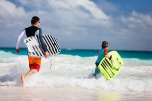 Dad and son bodyboarding